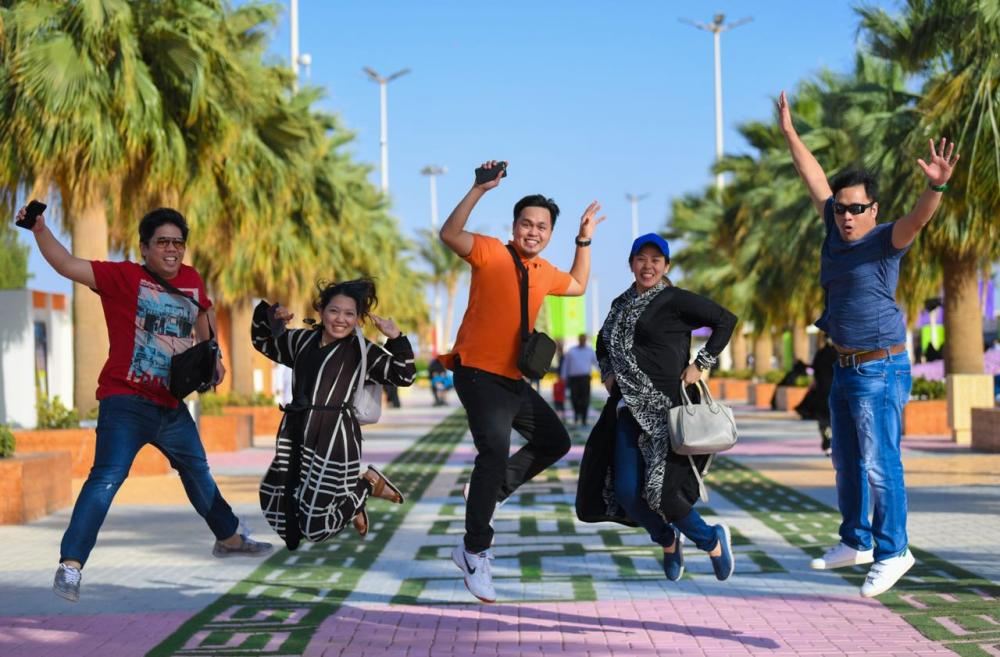 A group of expatriates celebrates after visiting the flower show in Yanbu.
