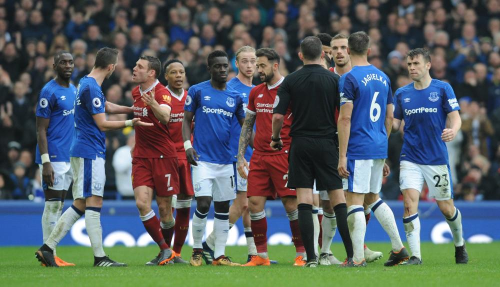 Everton and Liverpool players react during their English Premier League match at Goodison Park in Liverpool Saturday. — EPA