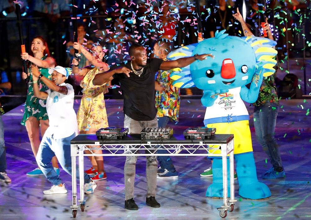 Former Jamaican sprinter Usain Bolt plays the DJ desks during the closing ceremony of the Gold Coast 2018 Commonwealth Games Sunday. — Reuters