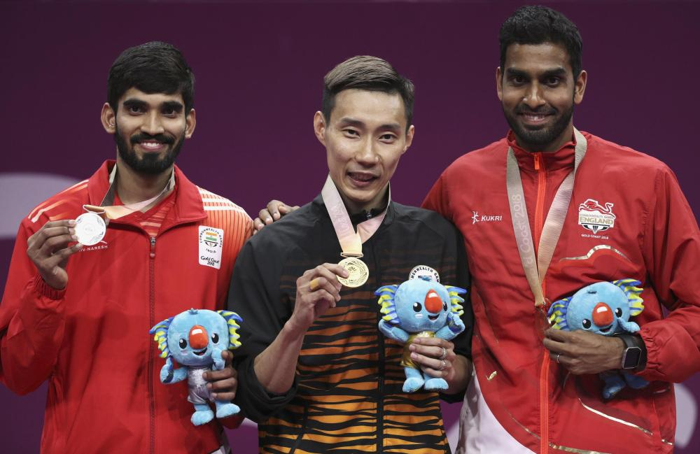 Gold medalist Lee Chong Wei of Malaysia, Srikanth Kidambi (silver) of India and Rajiv Ouseph (bronze) of England pose with their medals and Borobi plush dolls at the Gold Coast 2018 Commonwealth Games Sunday. — Reuters