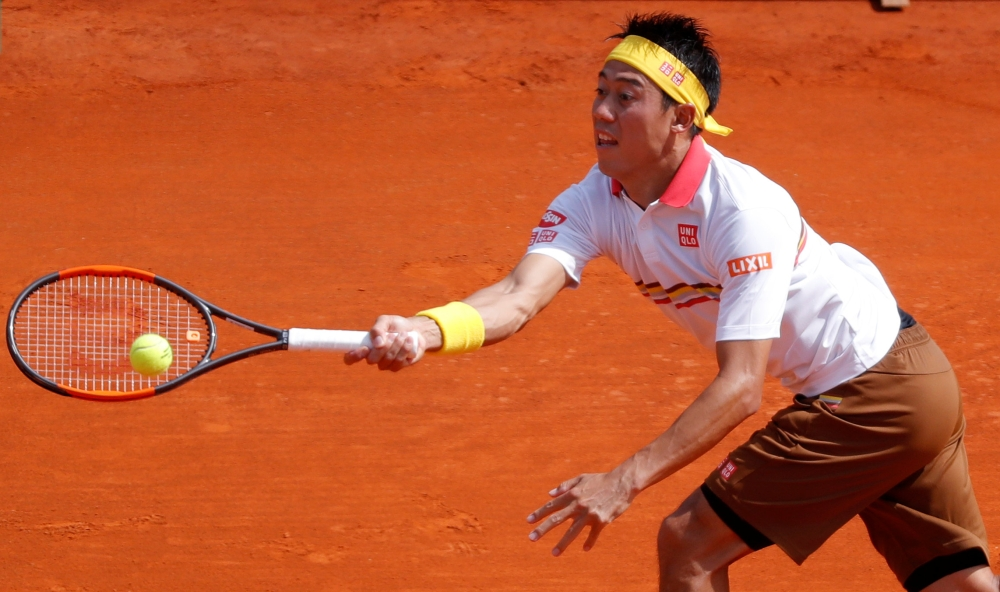 Japan's Kei Nishikori in action against Czech Republic's Tomas Berdych during the first round of the ATP - Monte Carlo Masters at the Monte-Carlo Country Club, Monaco, on Sunday. — Reuters