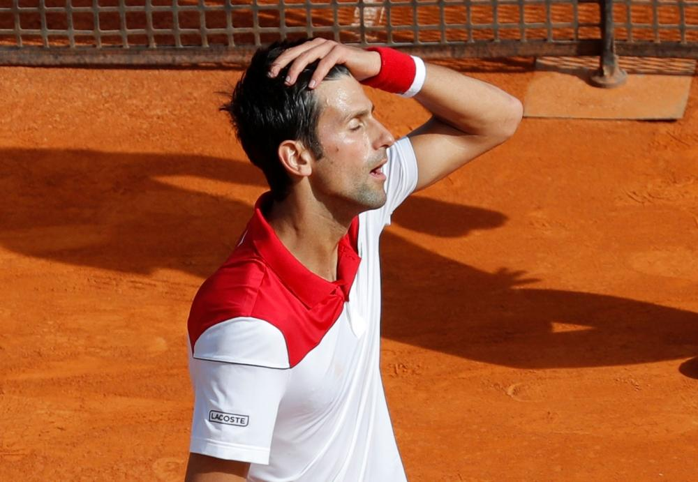 Serbia's Novak Djokovic celebrates winning his first round match against Serbia's Dusan Lajovic in the Monte Carlo Masters at the Monte-Carlo Country Club, Monaco, on Monday. — Reuters