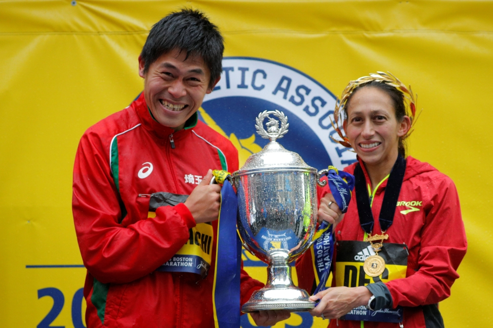 Yuki Kawauchi of Japan and Desiree Linden of the US celebrate with the trophy after winning the men's and women's divisions of the 122nd Boston Marathon in Boston, Massachusetts, US, Monday. — Reuters