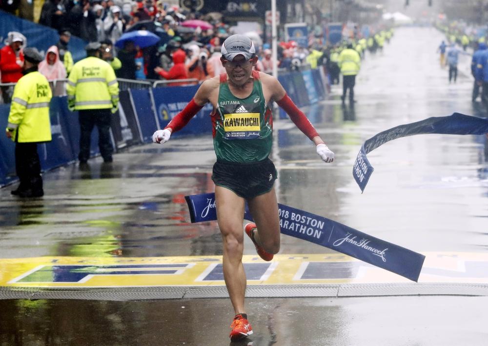 Yuki Kawauchi of Japan hits the tape to win the Men's Division of the 2018 Boston Marathon on Monday. — Reuters