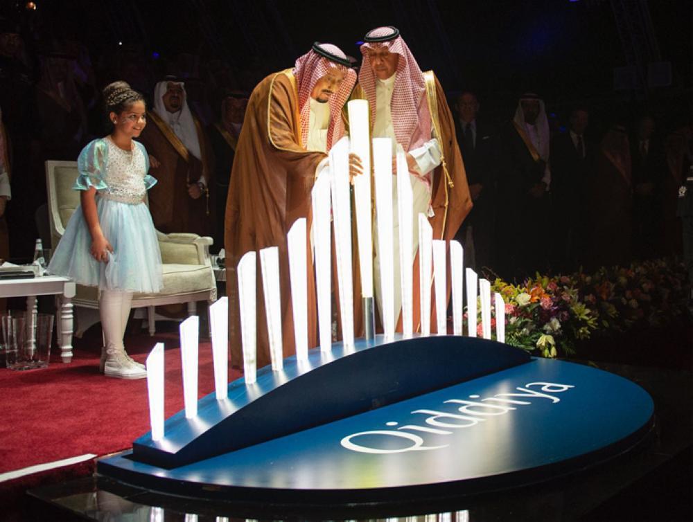 King Salman places the last baton of the Qiddiya logo to launch the Qiddiya project during a ceremony in Riyadh on Saturday. - SPA photos