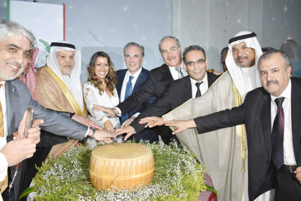 The Italian diplomats along with Ambassador Jamal Balkhoyor and other diplomats cutting the cake of the ceremony.