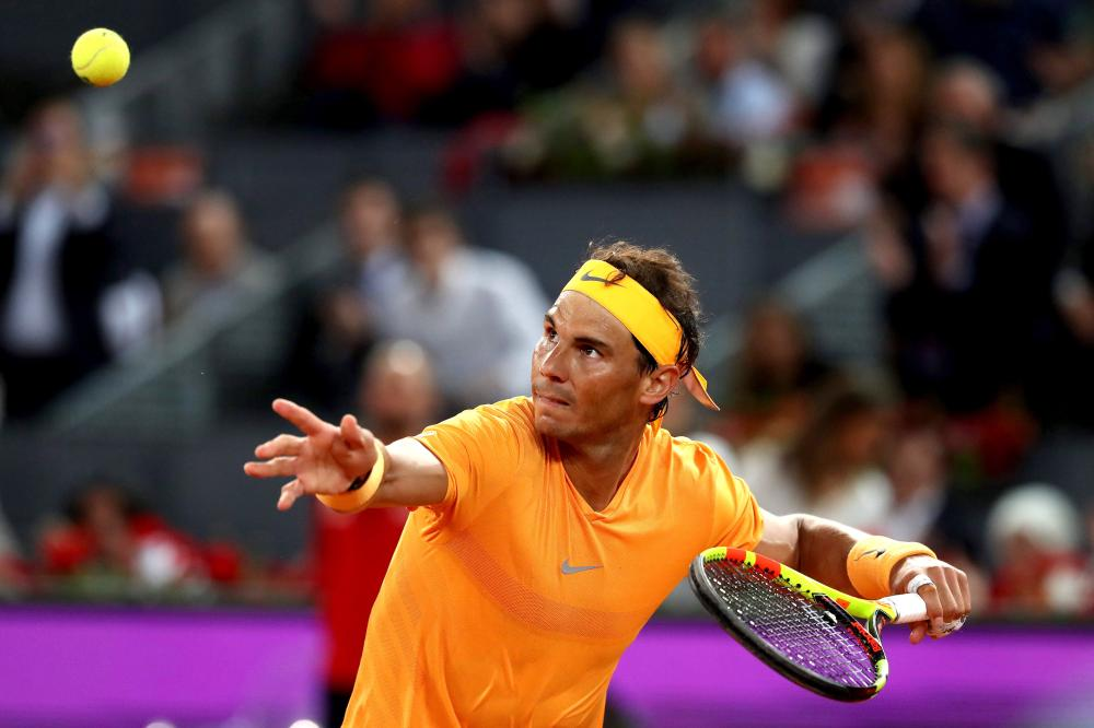 Record-breaking Nadal brings up half-century, Lajovic stuns del Potro