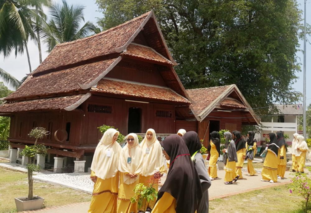 Women visit one of the oldest mosques in Pattani.
