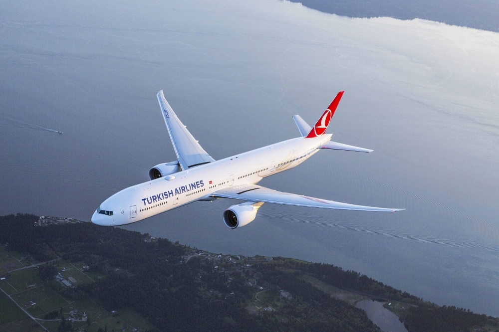 Turkish Airlines Boeing 777-300ER photographed on 6 April 2015 from Wolfe Air Aviation Learjet 25B by Chad Slattery.