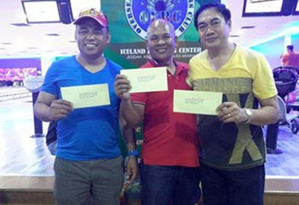 Men's division winners, from left, Cesar Pagtalunan, Alexander Duma and Nap Patayan.