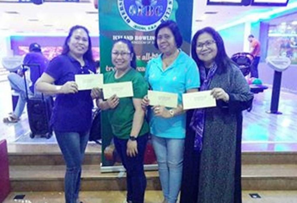 Ladies' division winners, from left, Carmen Duma, Vilma Miranda, Aisah Silabay and Carmen Bernardo.