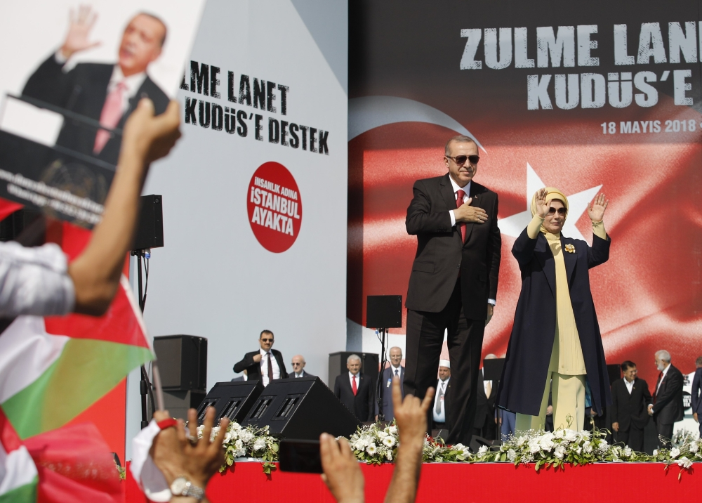 Turkish President Tayyip Erdogan, accompanied by his wife Emine Erdogan, greets the crowd in Istanbul on Friday during a protest against the recent killings of Palestinian protesters on the Gaza-Israel border and the US embassy move to occupied Jerusalem. — Reuters