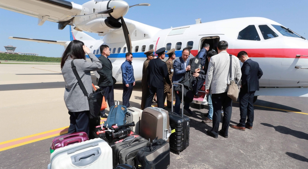 South Korean journalists who will visit the nuclear testing site at Punggye-ri arrive at Kalma airport in Wonsan North Korea Thursday. — Reuters