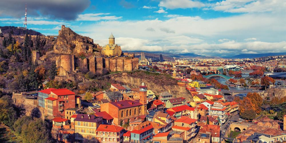 A beautiful panoramic view of Tbilisi at sunset.
