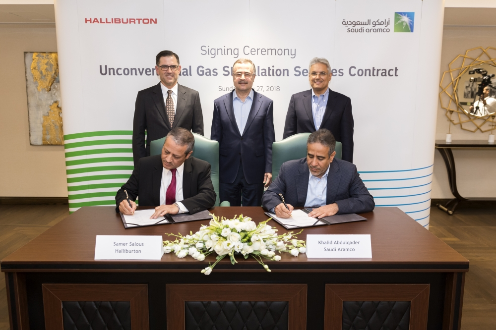 Saudi Aramco CEO Amin H. Nasser (standing center), Halliburton CEO Jeffrey A. Miller (standing, first from left)  and Saudi Aramco Sr. VP for Upstream Mohammed Y. Al Qahtani (standing, first from right), attend the signing ceremony for unconventional gas stimulation services contract on May 27, 2018 at Saudi Aramco headquarters in Dhahran, Saudi Arabia