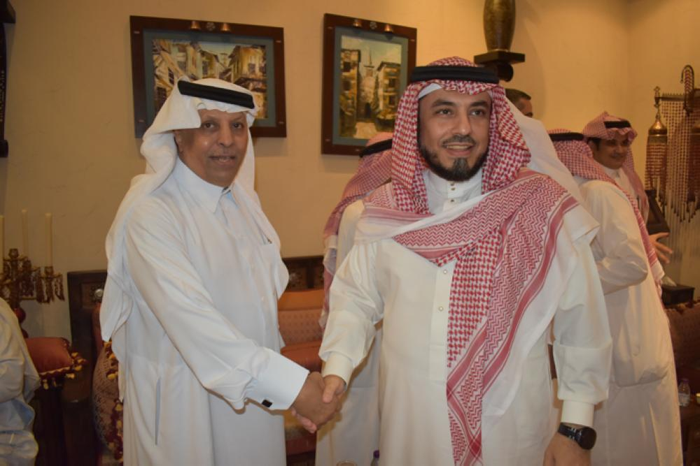 Left Mohammed Al-Nefaie receiving guests.