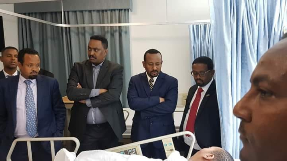 Ethiopian Prime Minister Abiy Ahmed visits the victim in hospital.
