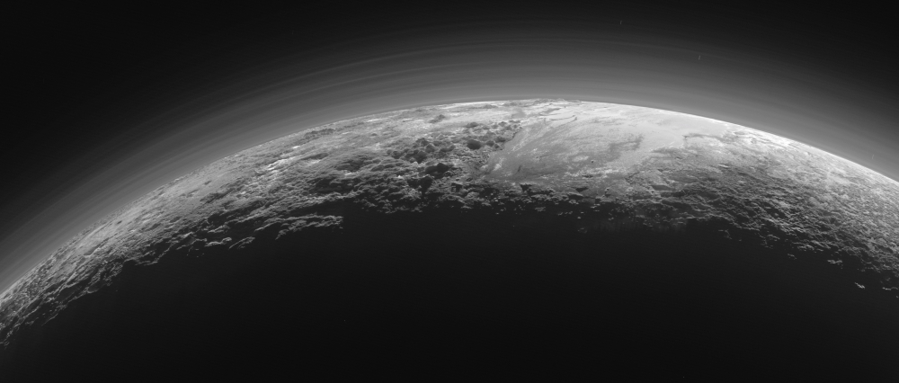 A handout photo made available by NASA on June 1, 2018 shows an image captured by NASA's New Horizons spacecraft as it looked toward the sun for a near-sunset view of the rugged, icy mountains and flat ice plains extending to Pluto's horizon on July 14, 2015. An international team of scientists said on Thursday, that dunes, possibly composed of sand-sized grains of solid methane ice, have been identified in the Sputnik Planitia region of the dwarf planet. The team analyzed the images of Pluto taken in 2015 by NASA's New Horizon spacecraft. — EPA
