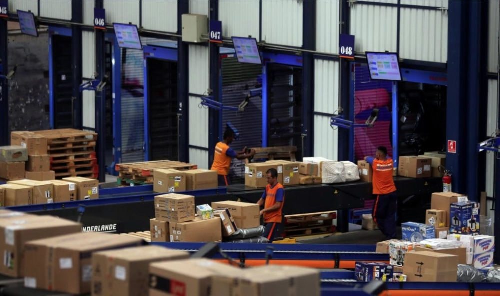 Employees work at trucking and logistics firm Braspress in Guarulhos, Brazil. — Reuters