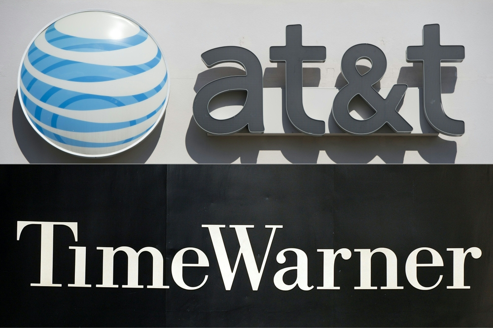 This combination of pictures  shows an AT&T cellphone store (TOP) in Springfield, Virginia, and the Time Warner company logo on the front of the headquarters building in New York.  — AFP