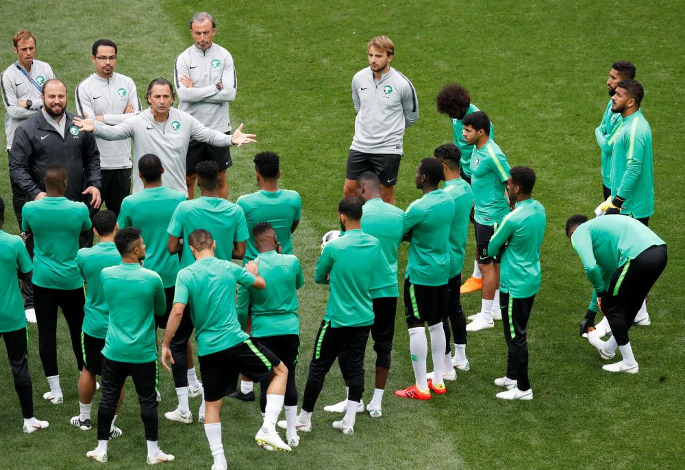 Saudi Arabia coach Juan Antonio Pizzi speaks with players during training at Luzhniki Stadium, Moscow, Wednesday. — Reuters