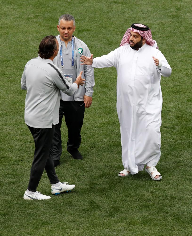 Saudi Arabia's Sports Minister Turki Al-Sheikh and Saudi Arabia coach Juan Antonio Pizzi greet each other during training  at Luzhniki Stadium, Moscow, Wednesday. — Reuters