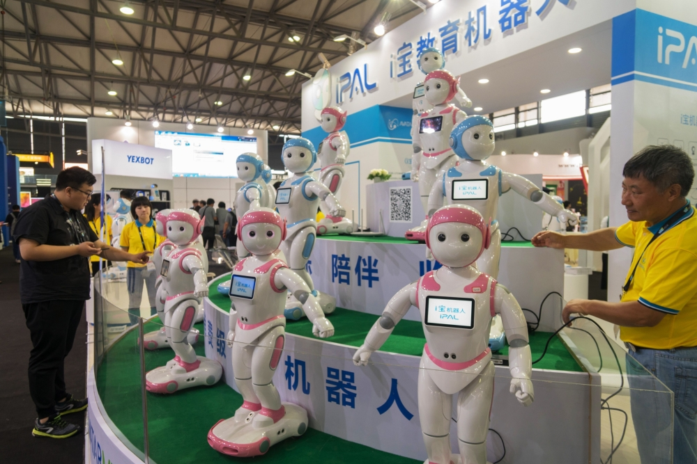 iPal robots by Avatarmind are exhibited at the Consumer Electronics Show (CES) Asia in Shanghai on Wednesday. A Chinese firm has a created a companion for children with few or no siblings in a country that limits births: