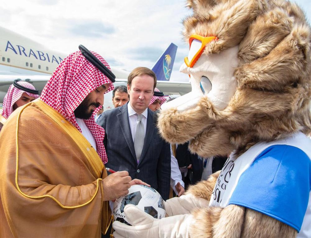 Crown Prince Muhammad Bin Salman, deputy premier and minister of defense signs an autograph on a football given by the World Cup Mascot upon arrival in Moscow on Thursday. Prince Muhammad will attend the opening match of the World Cup 2018. — SPA