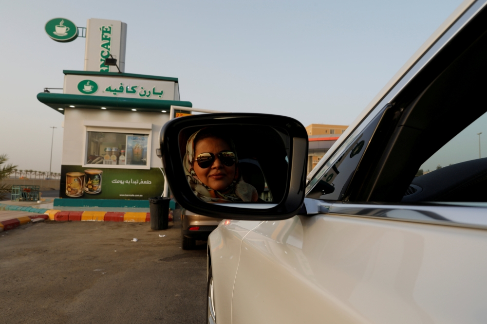 Samira Al-Ghamdi, a practicing psychologist, drives her car to work in Jeddah on Sunday. — Reuters