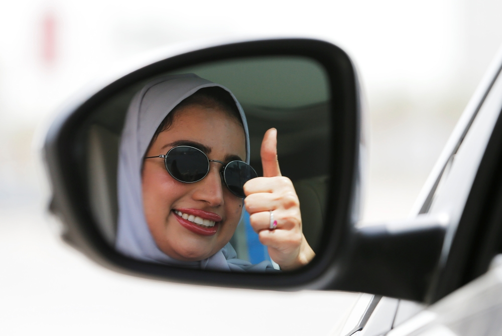 Zuhoor Assiri gestures as she drives her car in Dhahran. — Reuters