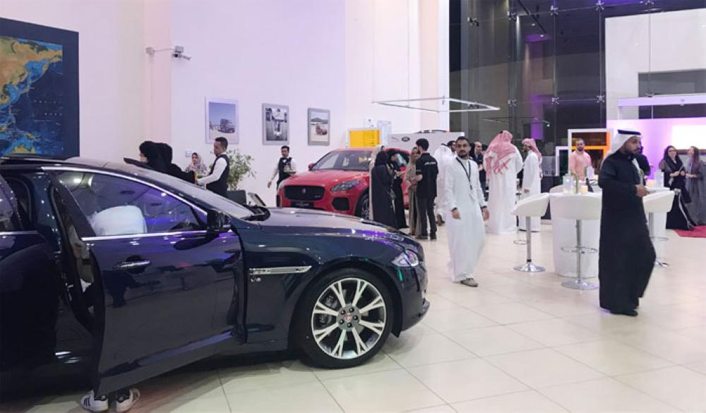 A car showroom receives women visitors.