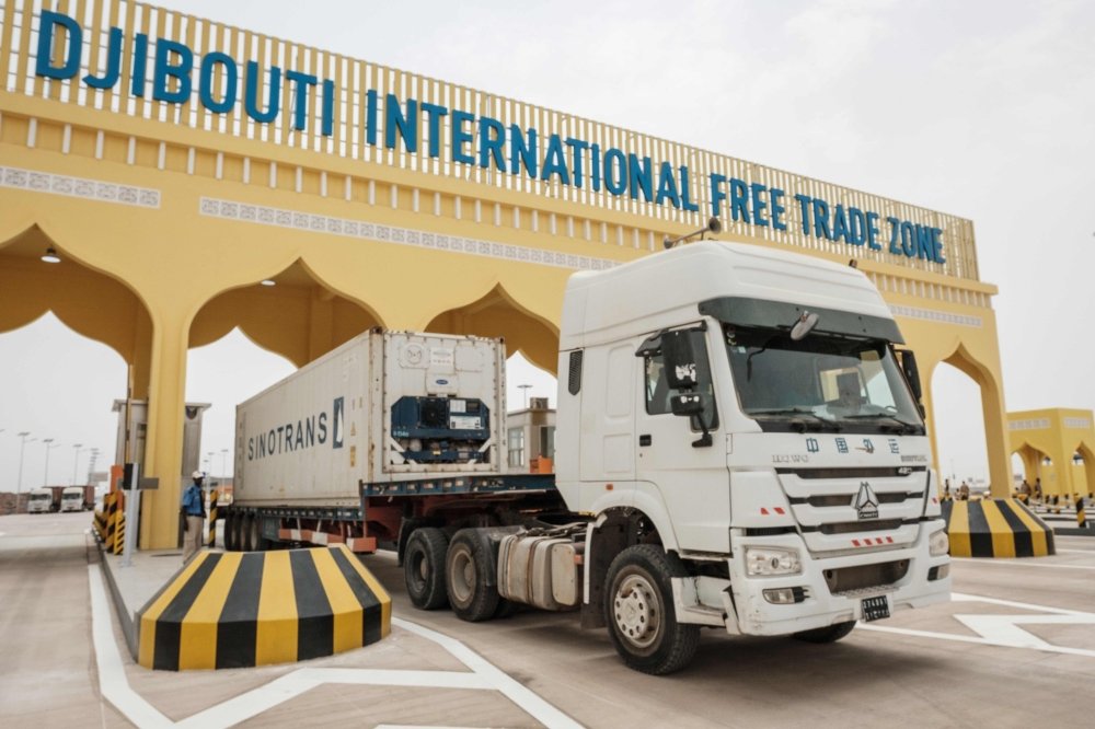 A container truck passes through the main gate of Djibouti International Free Trade Zone (DIFTZ) after the inauguration ceremony in Djibouti on Thursday. — AFP
