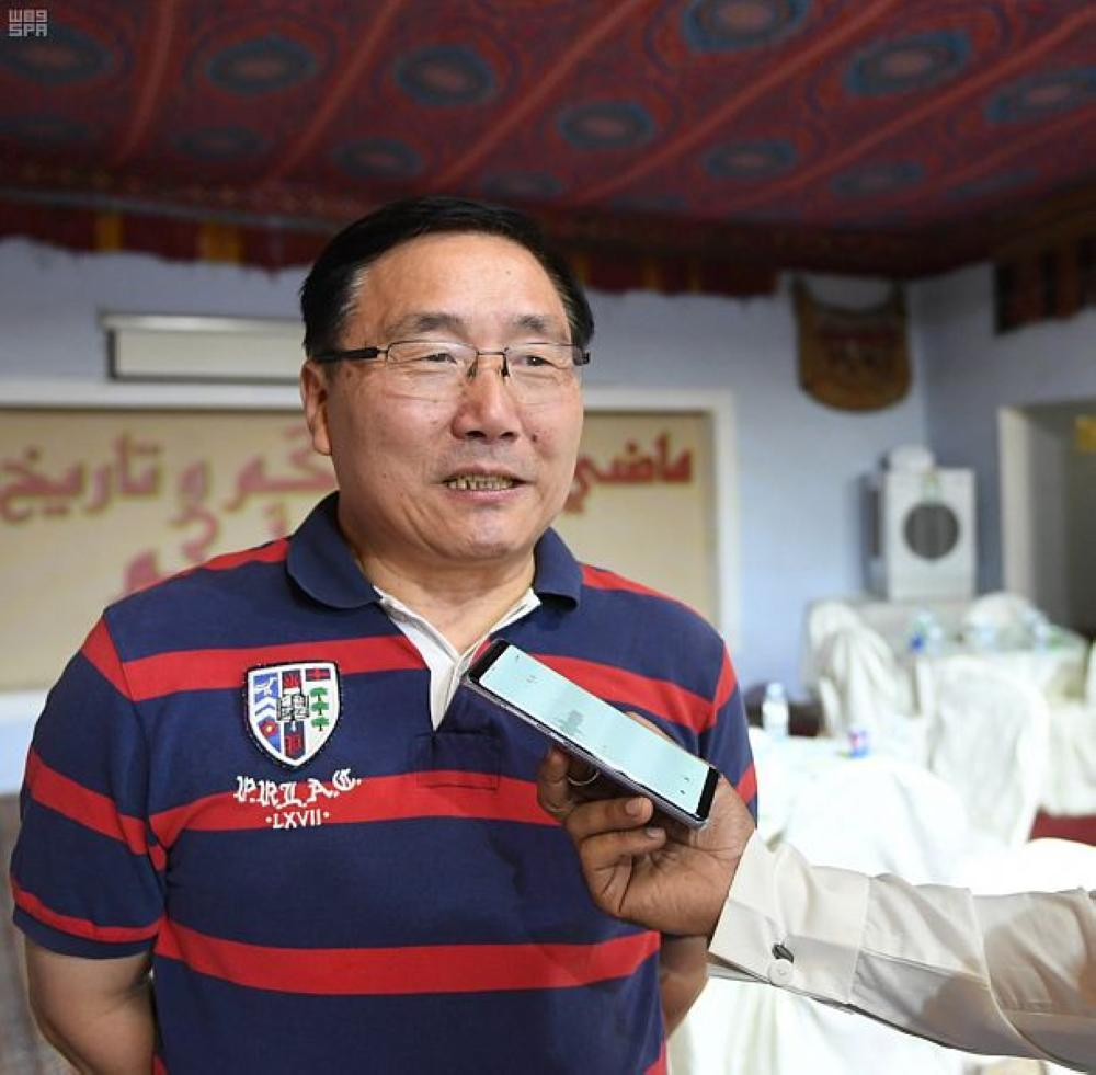 Chinese Ambassador to Saudi Arabia Li Huaxin speaks during the visit to Taif and Souk Okaz