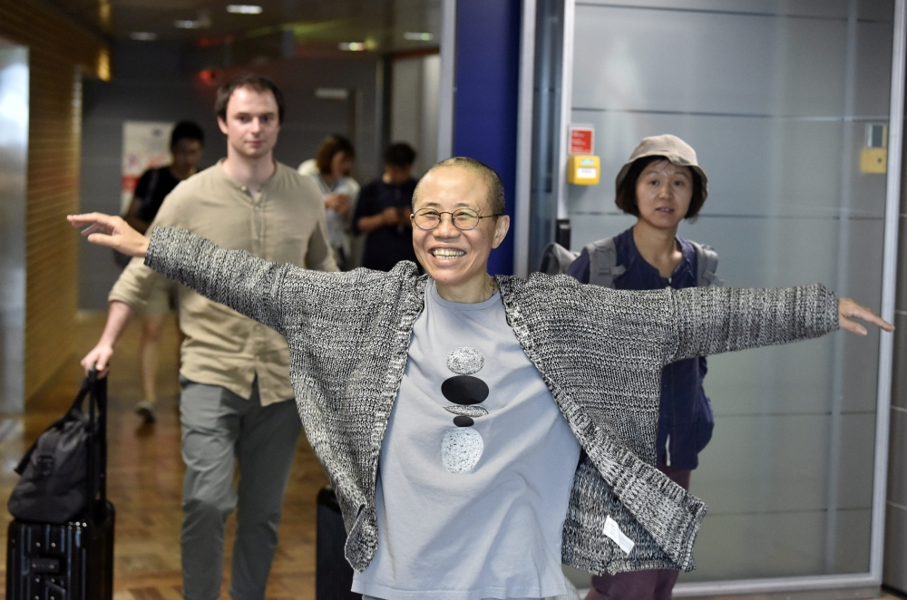 Widow of Chinese dissident leaves for Germany