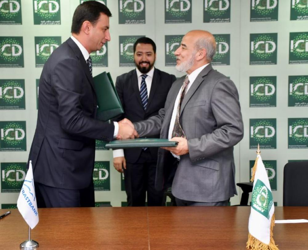 The Acting Chief Executive Officer of the Islamic Corporation for the Development of the Private sector (ICD) Najmul Hassan and the Chairman of the Management Board of the Private Joint-Stock Trustbank (Trustbank) Sardor Normukhamedov sign  a line of financing agreement at the ICD's head office in Jeddah on Tuesday
