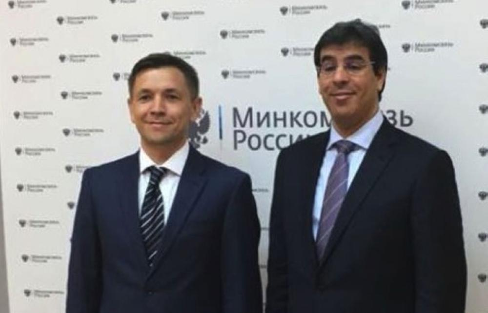 Minister of Media Awwad Al-Awwad with Russian Minister of Information and Communication Konstantin Noskov in Moscow on Wednesday.