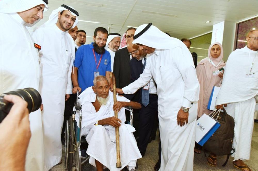 Saudi officials receiving Bangladeshi pilgrims at Jeddah Airport. A Biman flight carrying 400 pilgrims landed at the KAIA airport. — SPA