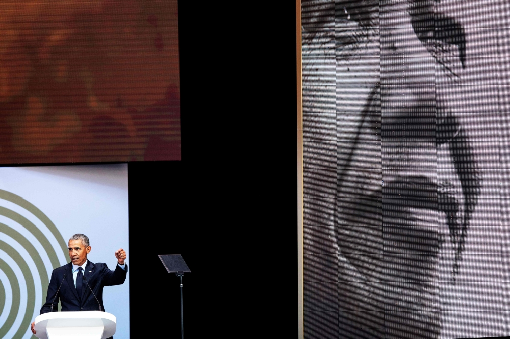 Former US President Barack Obama speaks during the 2018 Nelson Mandela Annual Lecture at the Wanderers cricket stadium in Johannesburg on Tuesday. — AFP