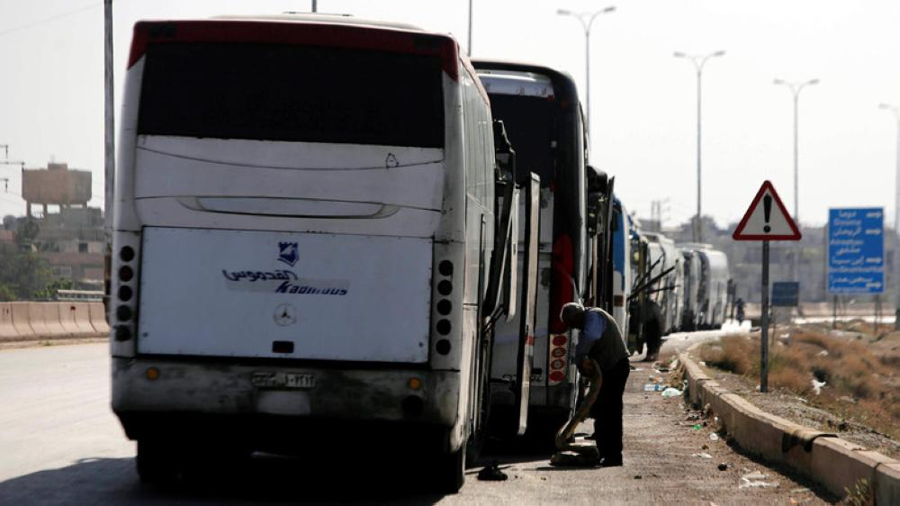 Buses arrive to evacuate two besieged pro-Assad villages