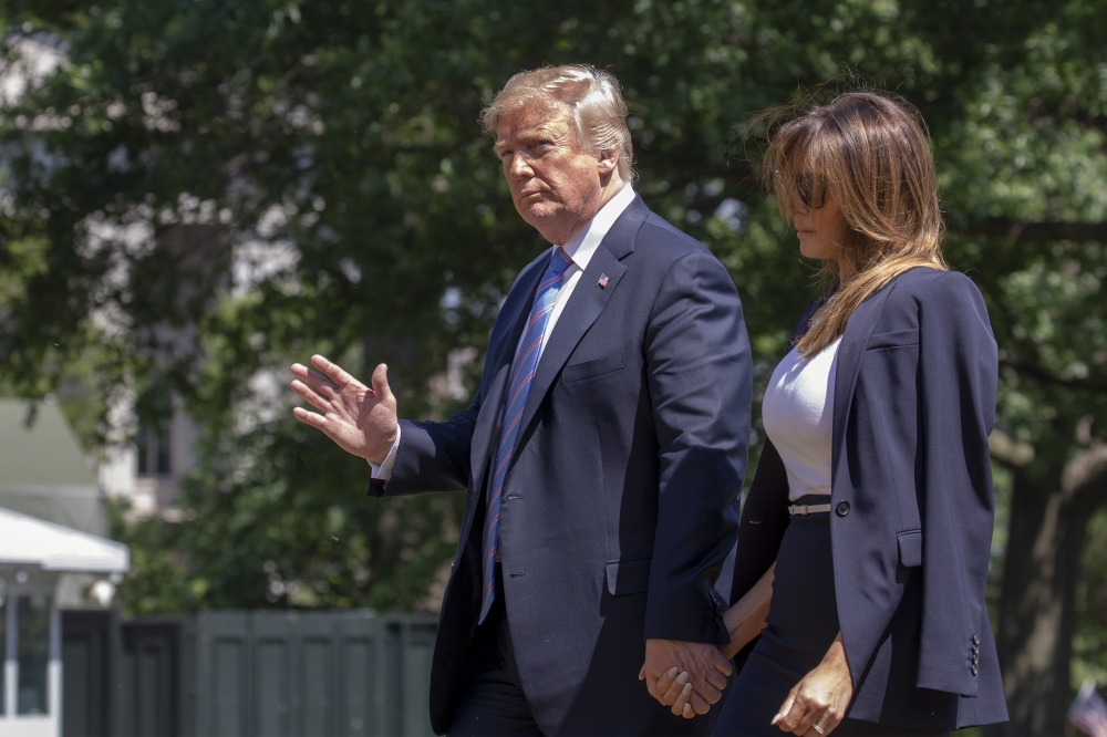 US President Donald Trump and First Lady Melania Trump return to the White House in Washington from Joint Base Andrews in Maryland on Wednesday. — AFP