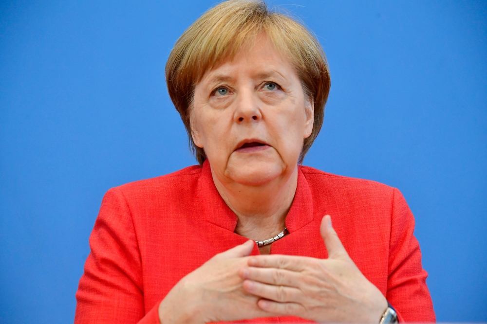 German Chancellor Angela Merkel attends her summer press conference in Berlin on Friday. — AFP
