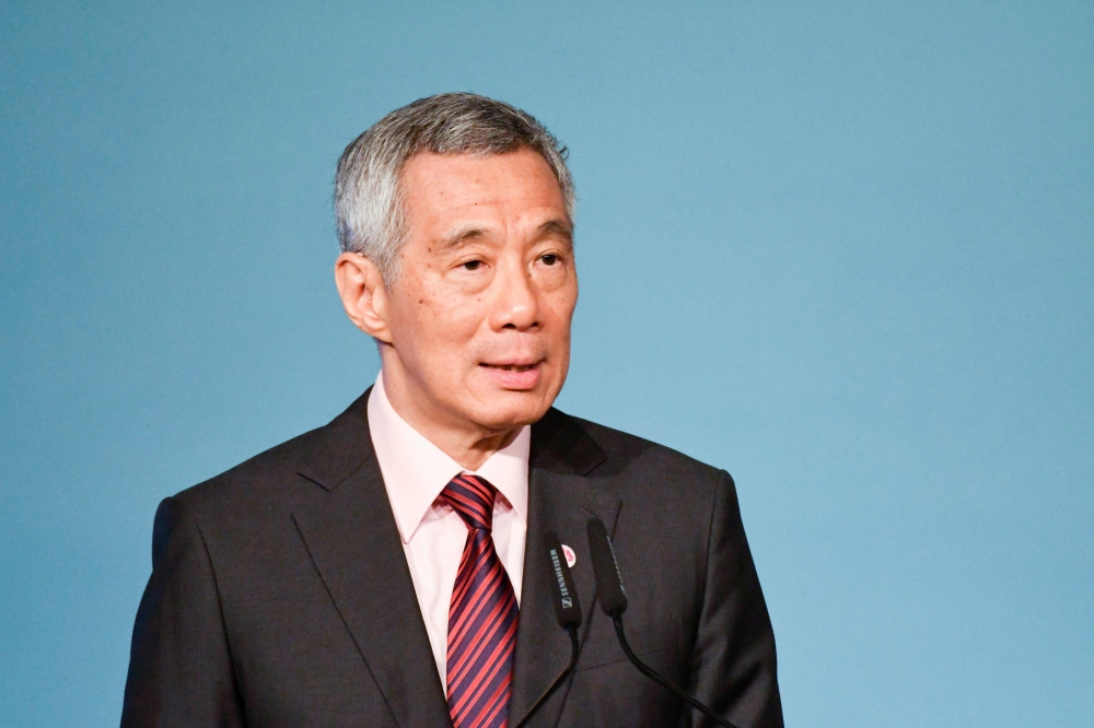 Singapore Prime Minister Lee Hsien Loong delivers his opening address at the 32nd ASEAN Summit in Singapore in this
