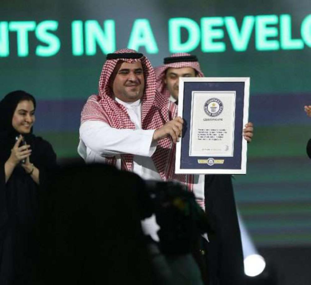Saudi Arabia Hajj Hackathon organized by the Saudi Federation for Cybersecurity, Programming and Drones in Jeddah, has broken the Guinness World Record in terms of the number of participants topping 2,950 from over 100 countries. This was announced on Thursday morning as Saud Al-Qahtani, Advisor at the Royal Court and chairman of the Saudi federation for cybersecurity and programming received the certificate from Ahmed Jaber, a judge from the Saudi Guinness World Record. Photo shows Saudi Al Qahtani raising the Guinness Book Certificate. — Courtesy photo
