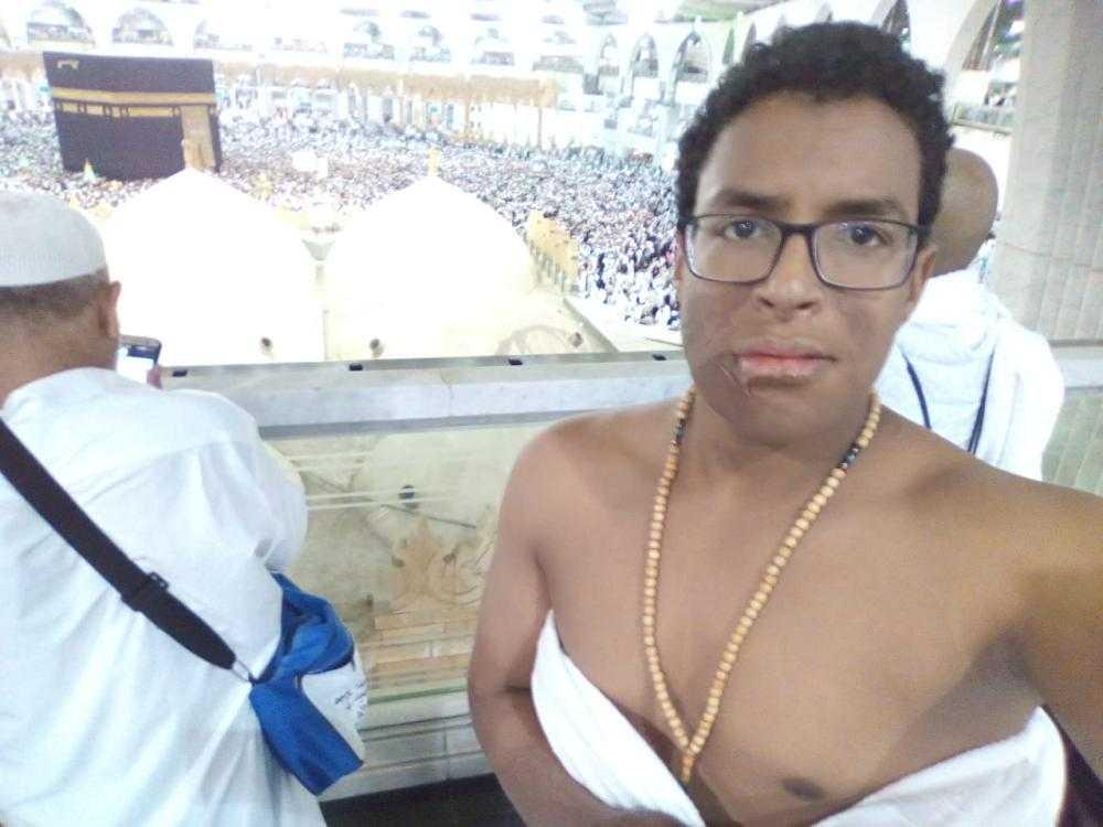 Mohammad Al-Fateh Othman, the lone survivor of a July 2003 plane crash in Sudan, at the Grand Mosque in Makkah performing Umrah, the minor pilgrimage before Haj.