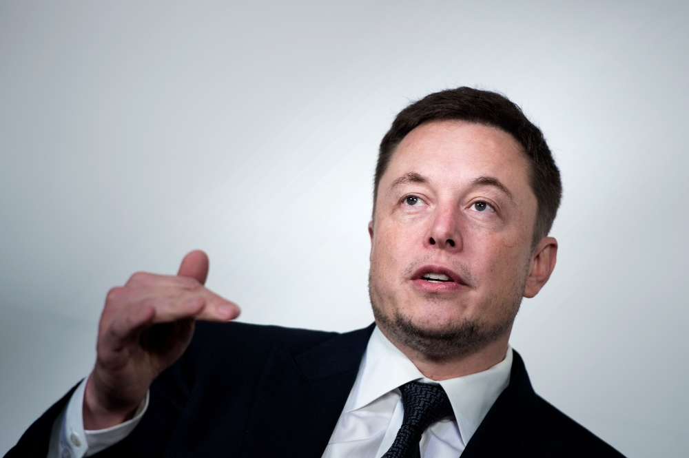 File photo shows Elon Musk, CEO of SpaceX and Tesla, speaks during the International Space Station Research and Development Conference at the Omni Shoreham Hotel in Washington, DC. — AFP