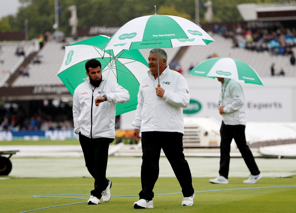 Cricket - England v India - Second Test - Lord's, London, Britain - August 9, 2018   Umpires on the pitch during a rain delay of the England versus India second cricket Test  at Lord's, London, on Thursday. — Reuters