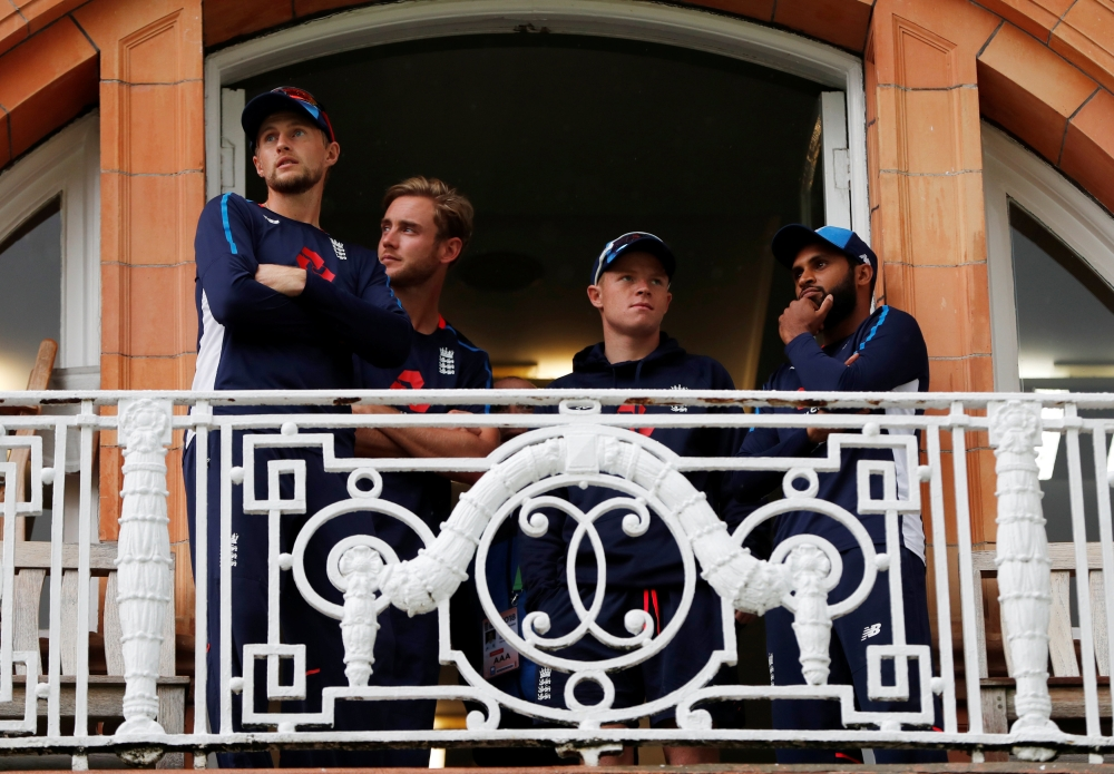 England's Joe Root, Stuart Broad, Adil Rashid and Ollie Pope on the players balcony during a rain delay  of the England versus India second cricket Test  at Lord's, London, on Thursday. — Reuters