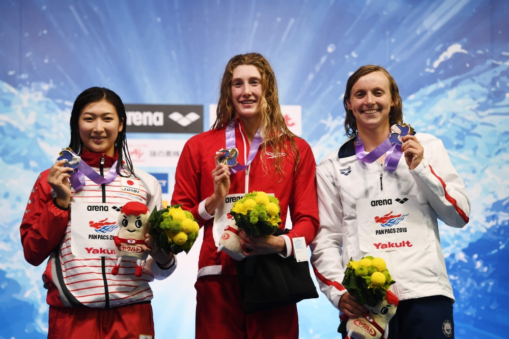 (From L) Japan's swimmer Rikako Ikee, Canada's swimmer Taylor Ruck and US swimmer Katie Ledecky pose on the podium of the 200m freestyle women final of the Pan Pacific Swimming Championships 2018 in Tokyo, on Thursday. — AFP