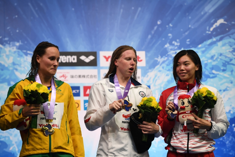 (From L) Australia's swimmer Jessica Hansen, US swimmer Lilly King and Japan's swimmer Reona Aoki pose on the podium of the 100m breastroke women final of the Pan Pacific Swimming Championships 2018 in Tokyo, on Thursday. — AFP