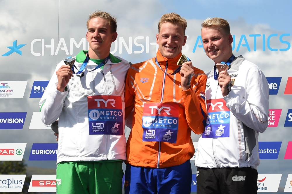 (L-R) Silver medalist Hungary's Kristof Rasovszky, gold medalist Netherland's Ferry Weertman and bronze medalist Germany's Rob Muffels pose on the podium at the medal ceremony for the men's 10km open water swimming at Loch Lomond, northwest of Glasgow, on Thursday during the 2018 European Championships. — AFP